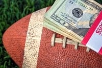 A football and dollars