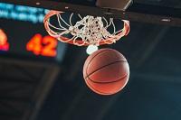 A basketball goes through the rim