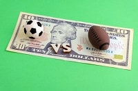 A dollar bill and two sport items