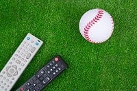 This image shows a baseball and two remote controllers