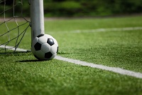 A soccer ball behind the line